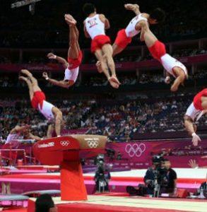 Опорный прыжок через козла Олимпийский игры Прыжки